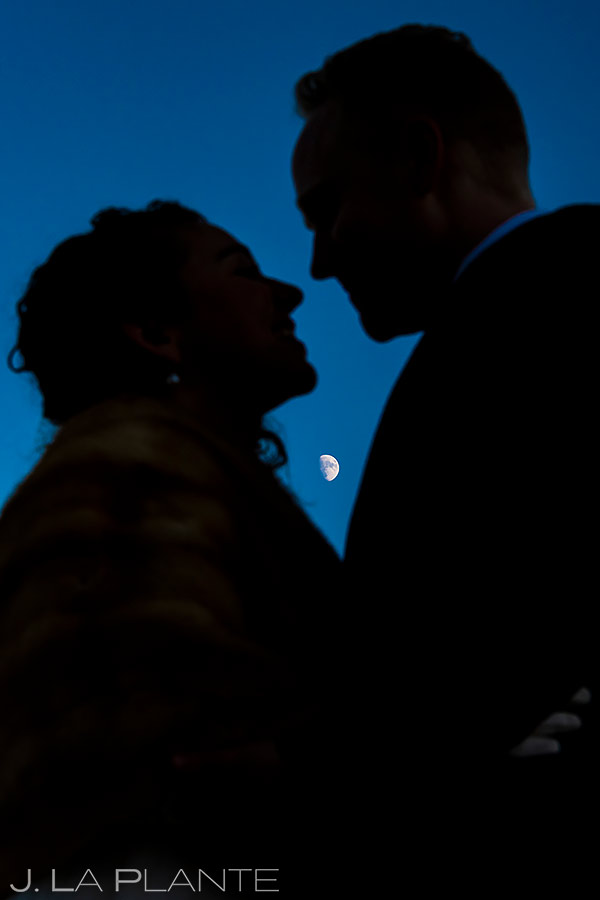 bride and groom silhouettes with the moon