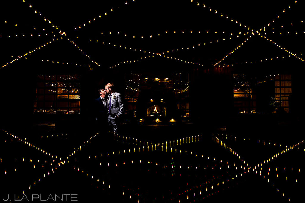 cool nighttime portrait of groom and groom