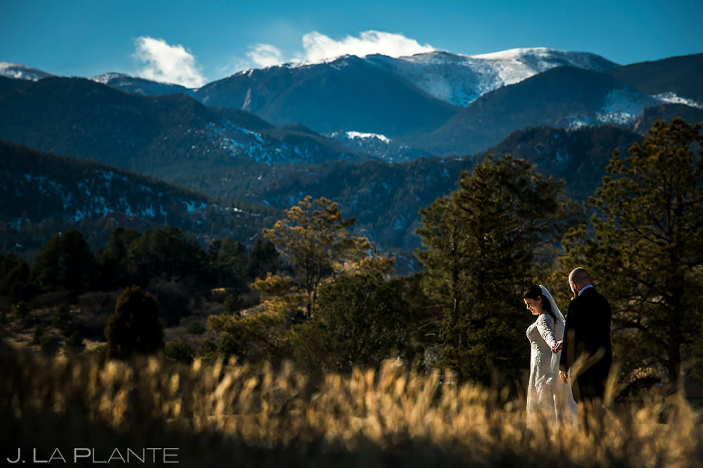 bride and groom walking in the mountains