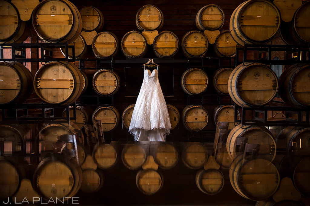 cool detail photo of dress hanging in wine cellar