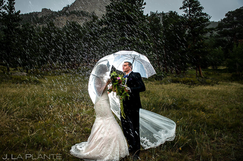 Bride and Groom in the Rain | Della Terra Wedding | Estes Park Wedding Photographer | J. La Plante Photo