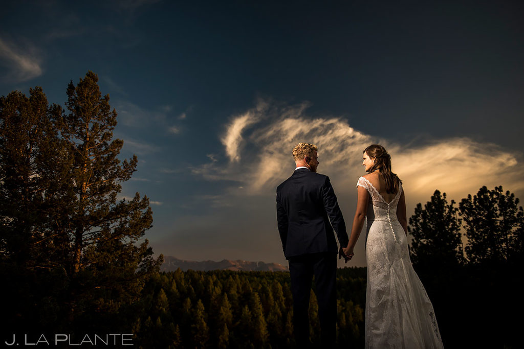 unique photo of bride and groom at sunset