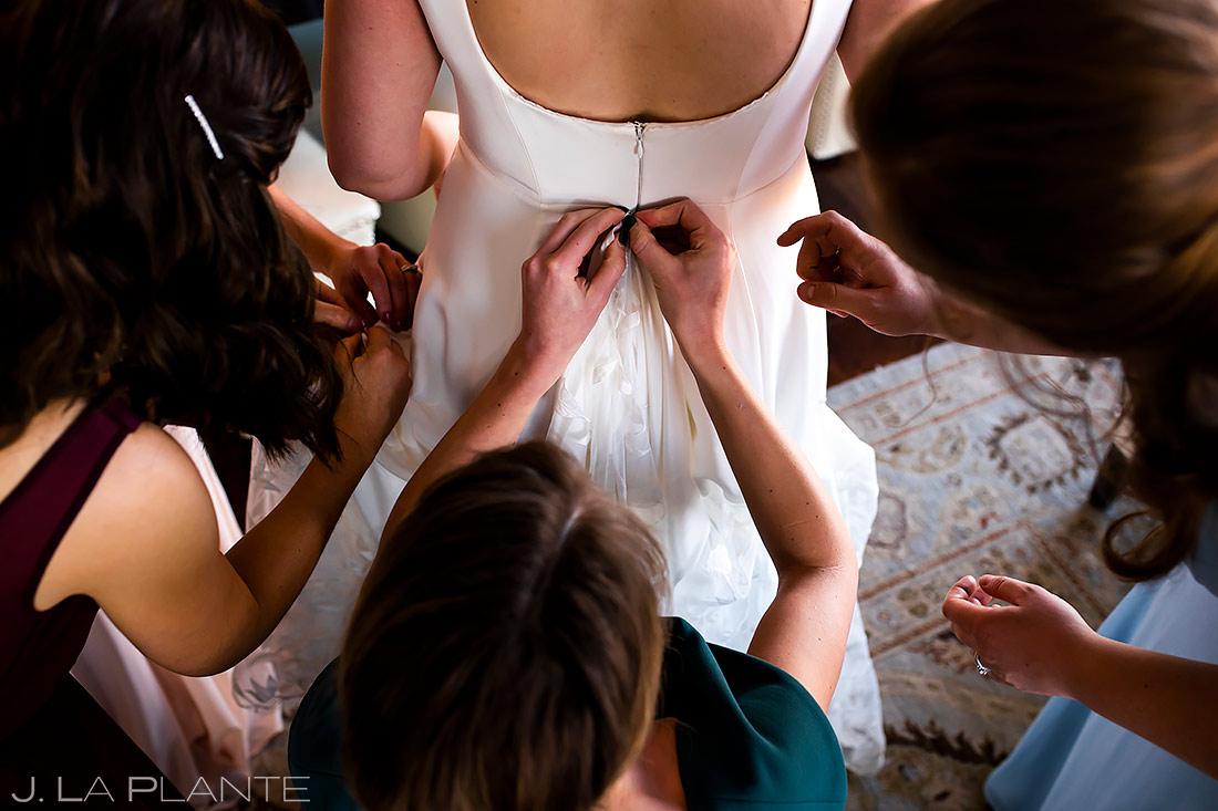 Bride Getting Dress Bustled | Pinery at the Hill Wedding | Colorado Springs Wedding Photographer | J. La Plante Photo