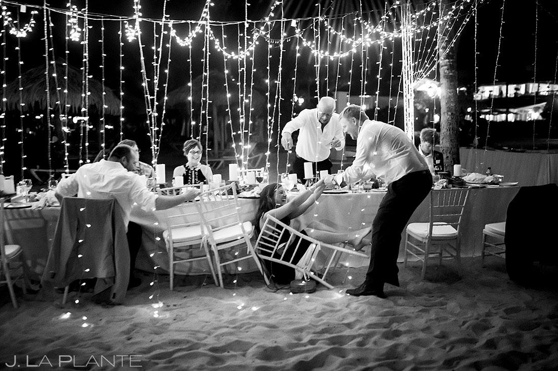 St. Lucia destination wedding guest falling out of chair | Destination wedding photographer