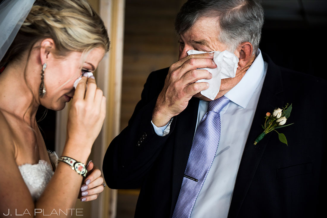 steamboat resort wedding bride crying with father candid wedding photography