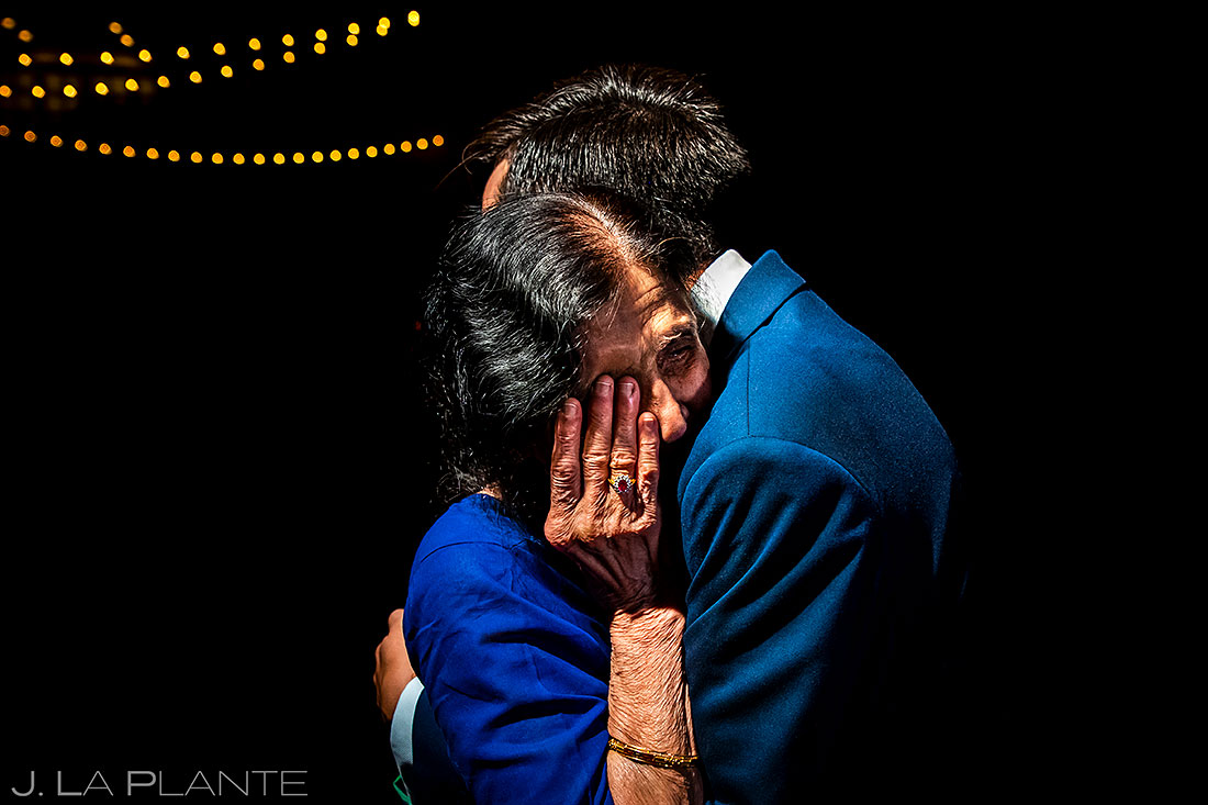 spruce mountain ranch wedding groom hugging grandma