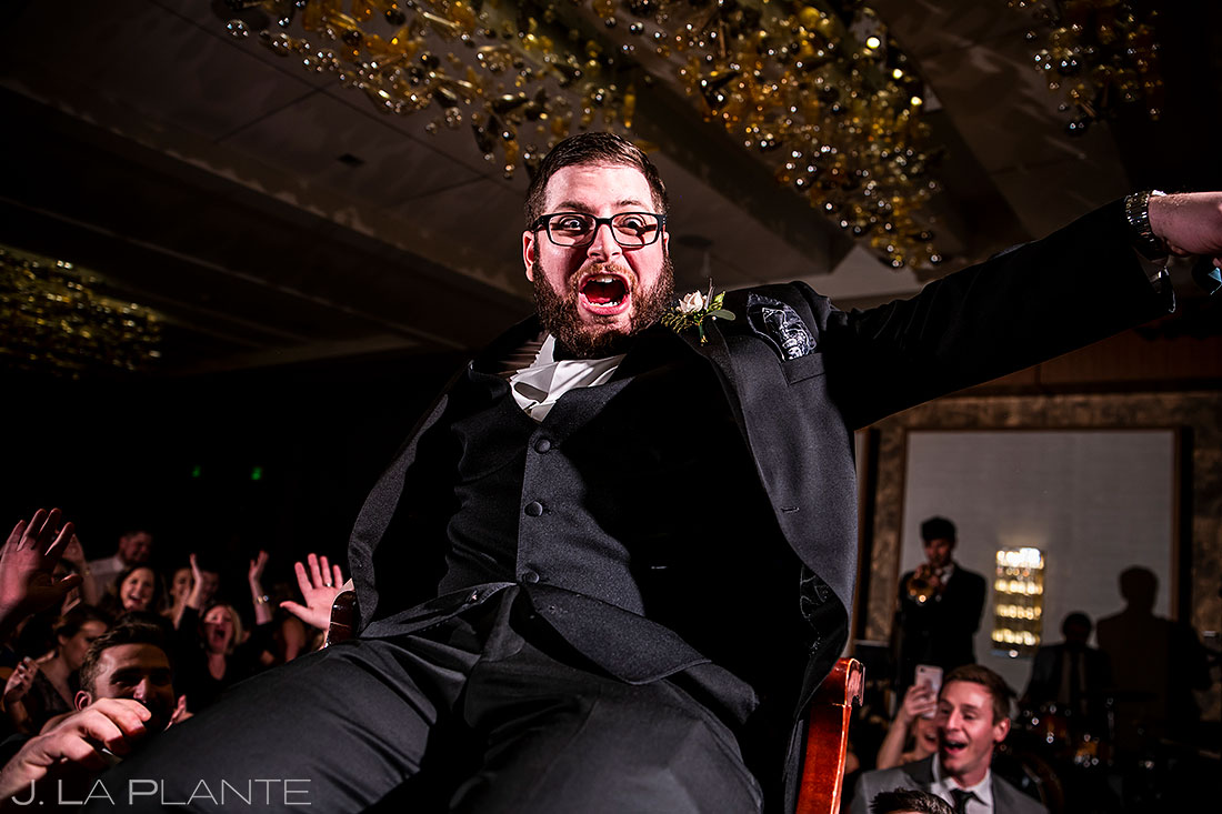 Grand Hyatt Denver wedding groom chair dance wedding photos that will put a smile on your face