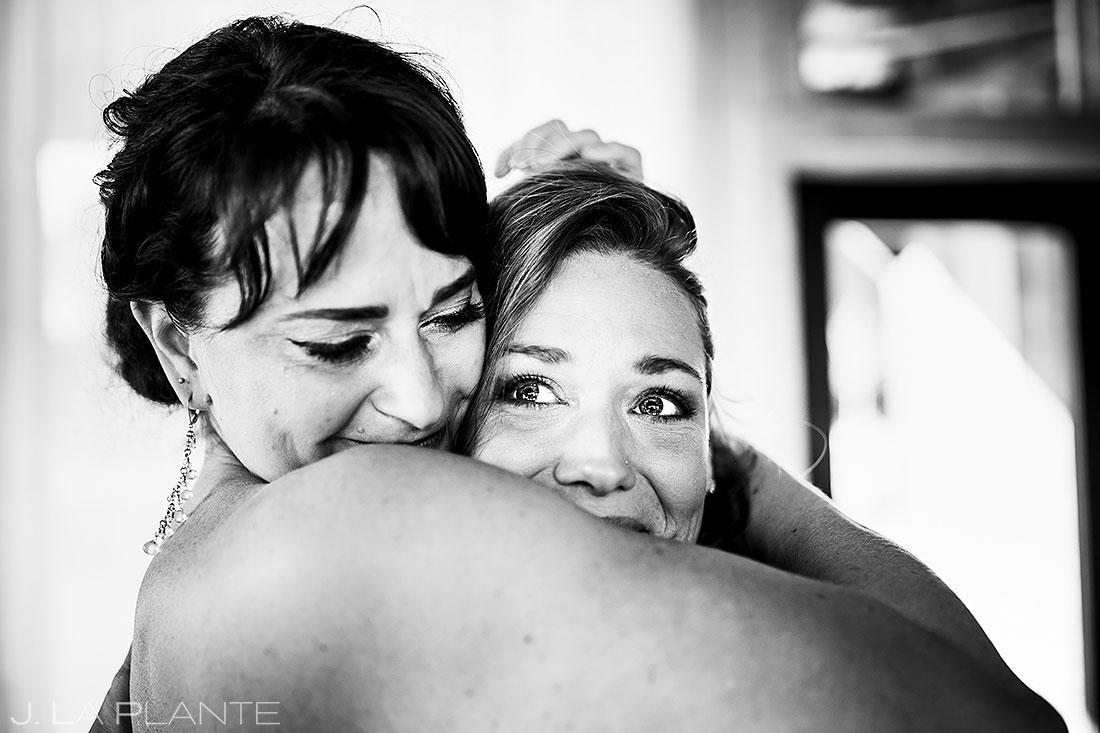 barnstar events wedding bride hugging bridesmaid candid wedding photography
