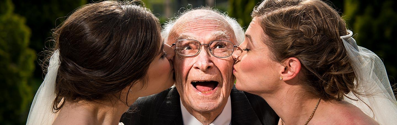 Denver Botanic Gardens wedding brides kissing grandfather