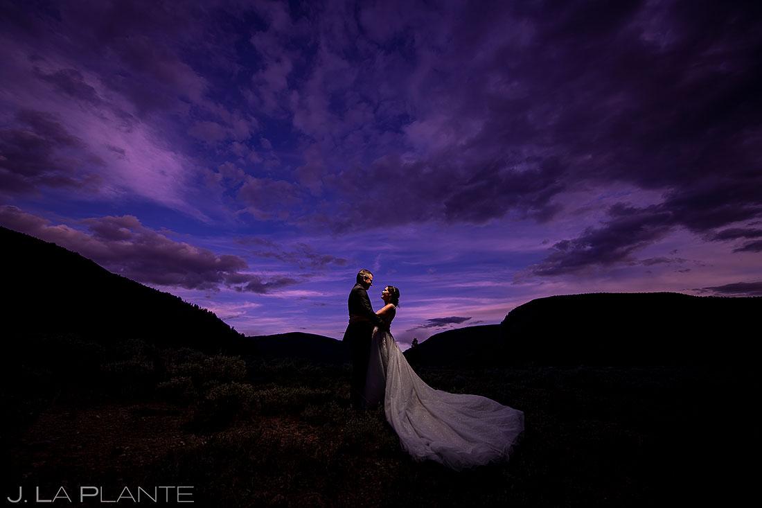 bride and groom portrait   colorful colorado sunset wedding
