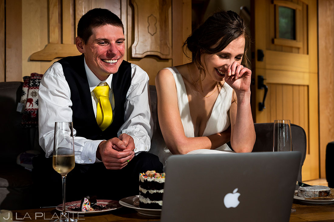 bride and groom video chatting with family