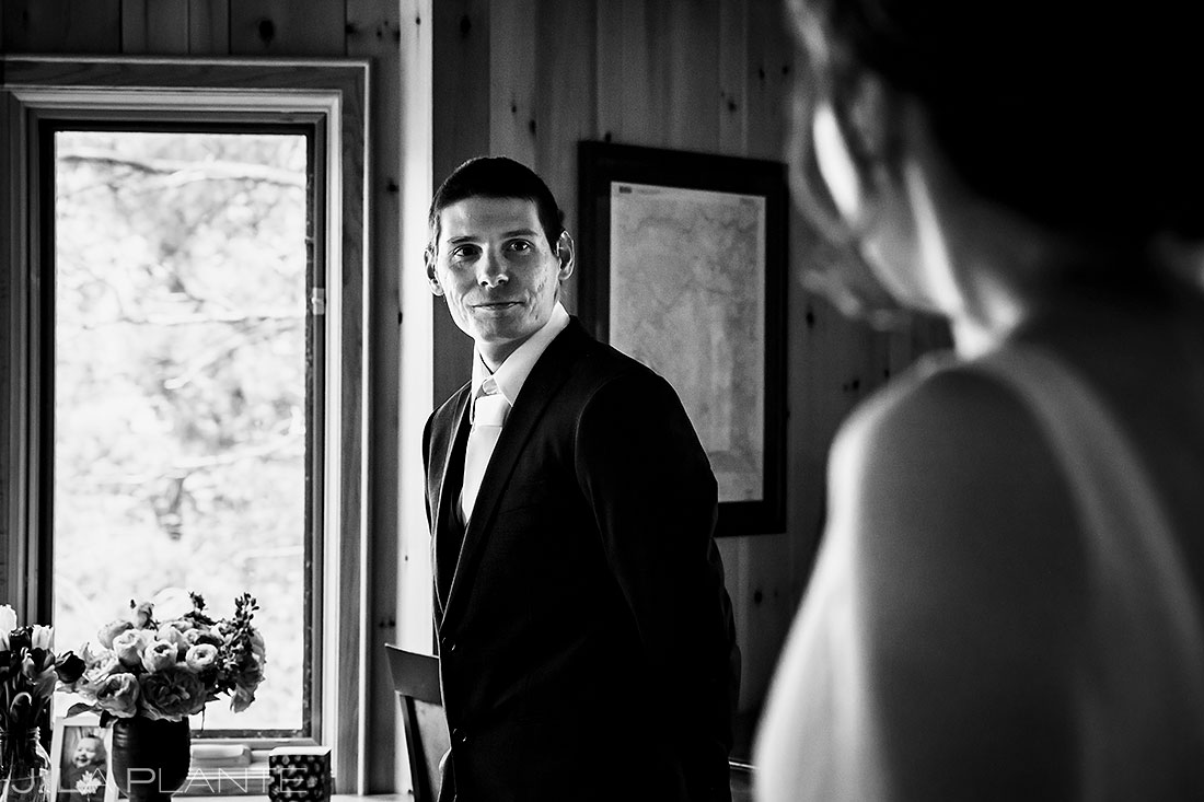 groom seeing bride for first time during colorado elopement