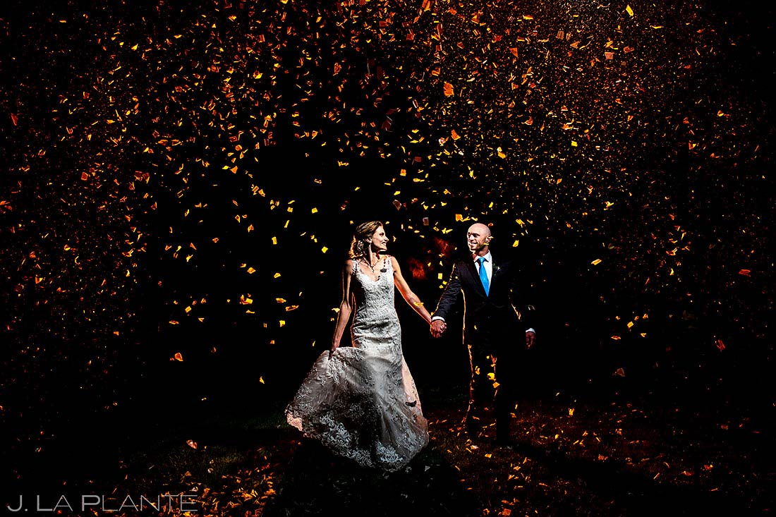 bride and groom with confetti cannons shupe homestead wedding