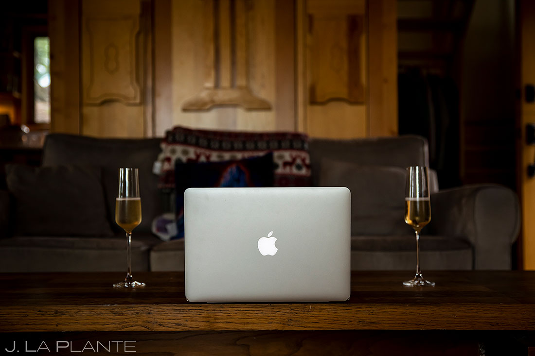 computer and champagne for zoom wedding