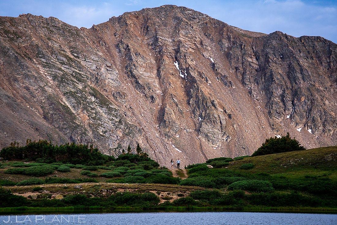 bride and groom to be hiking around pass lake colorado