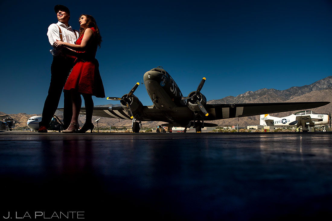 bride and groom hanging out in airplane hanger