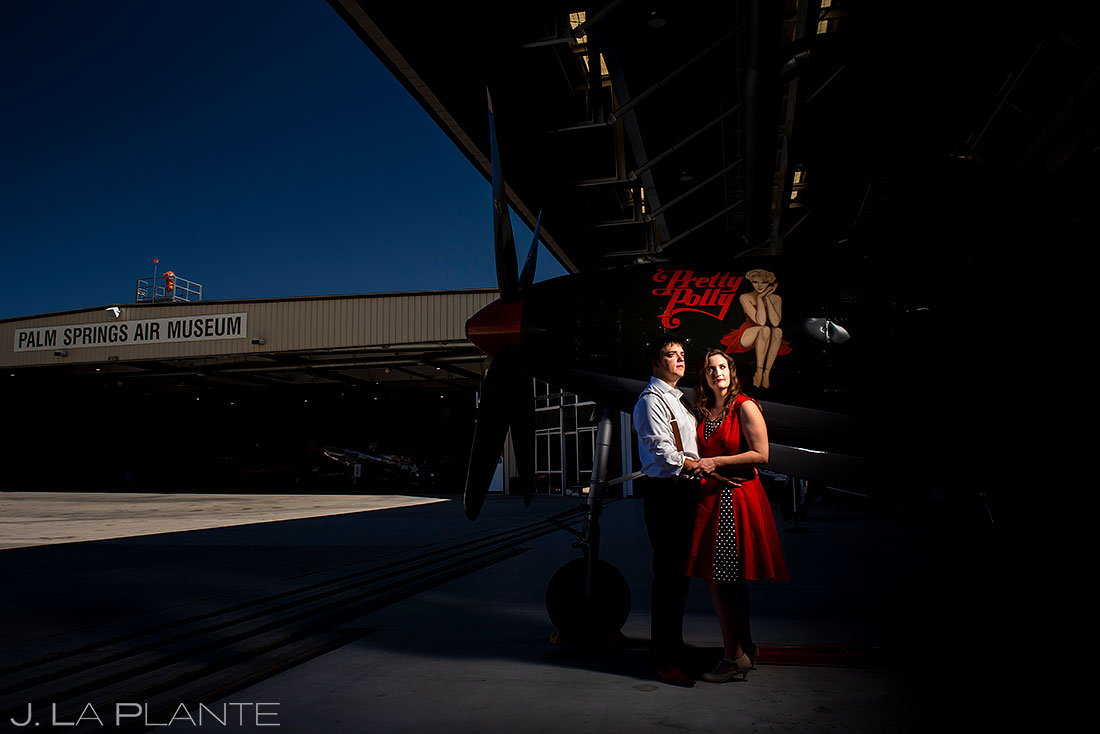 bride and groom to be with antique airplane