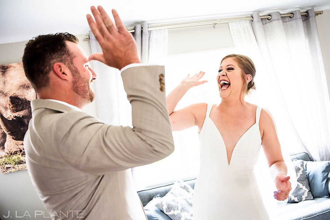 bride and groom high fiving after first look