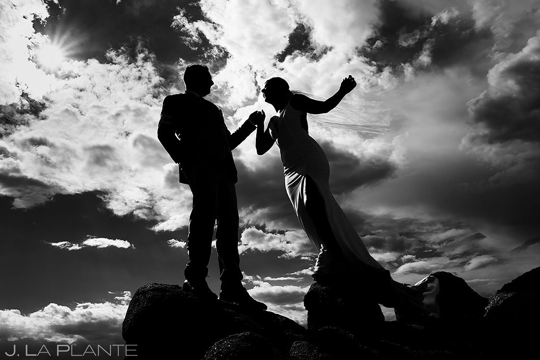 black and white silhouette photo of bride and groom