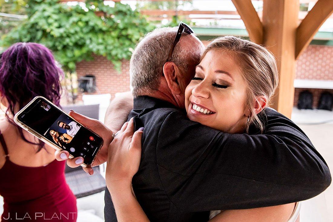 bride hugging her father after denver micro wedding ceremony