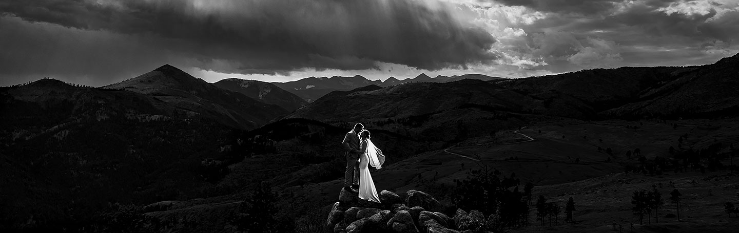 unique black and white portrait of groom on mountaintop