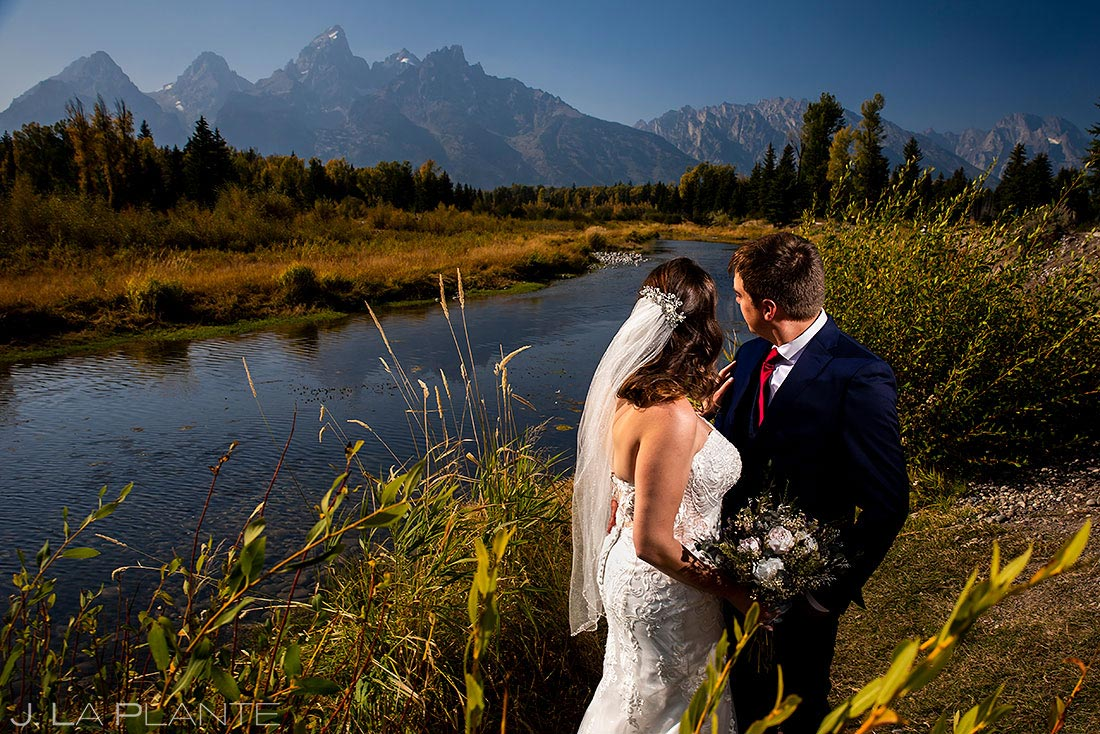 bride and groom by river during grant teton elopement