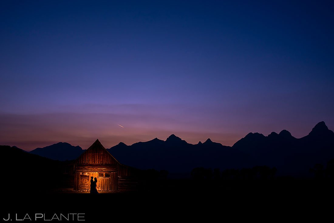 bride and groom silhouette photo at barn in the grand tetons
