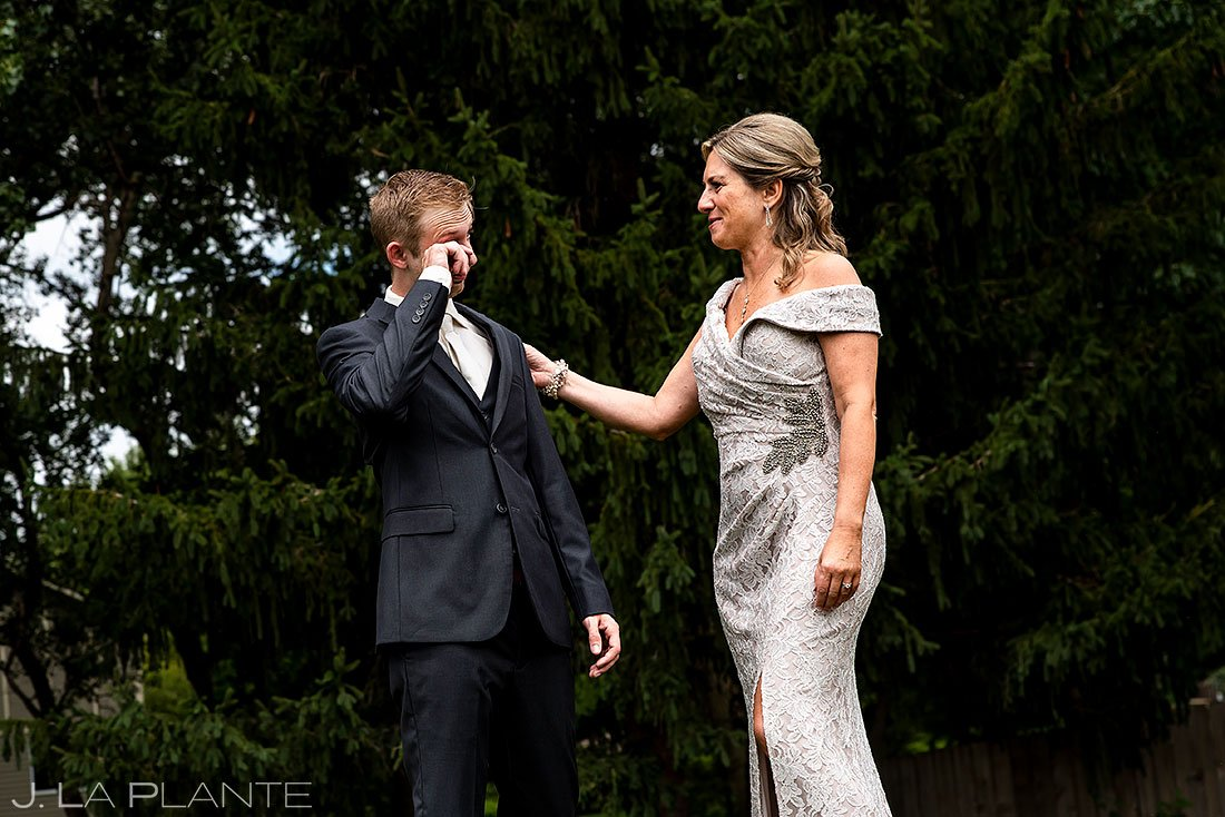 pandemic wedding in lincoln nebraska groom first look with mother