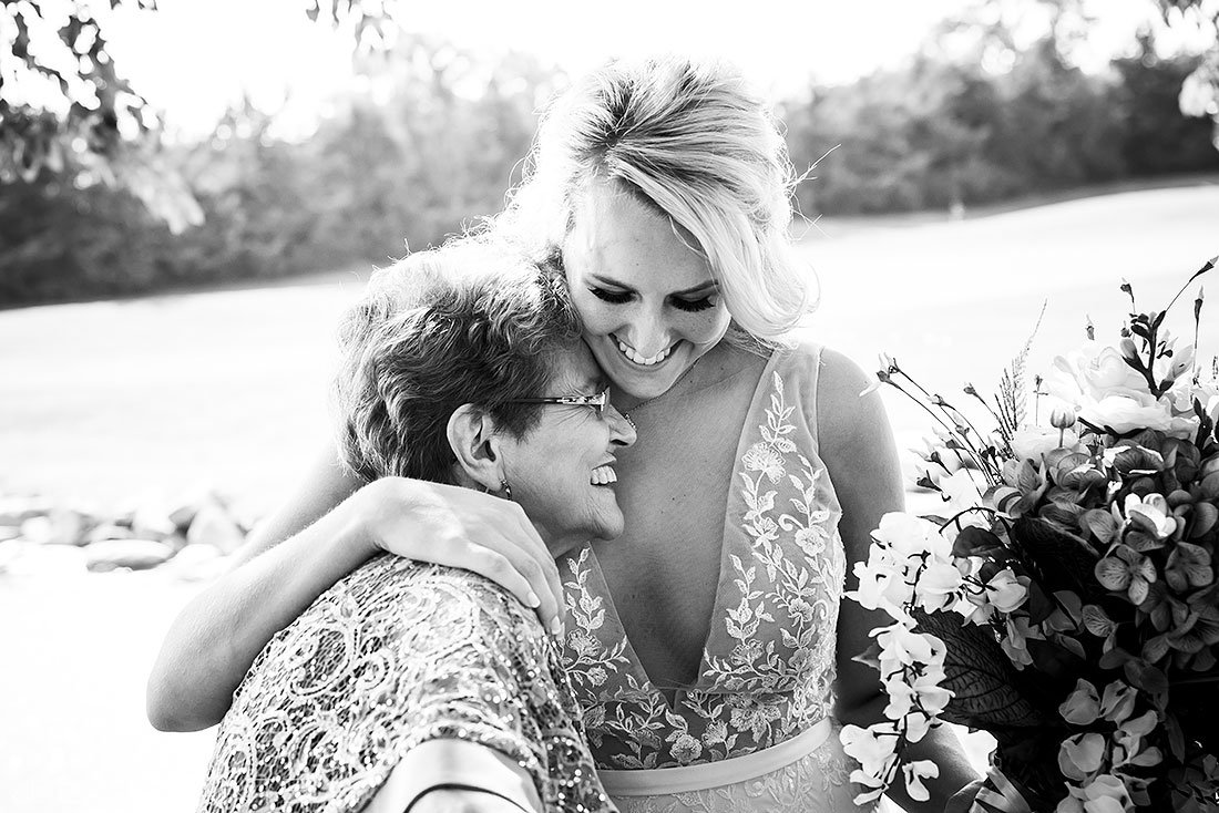 bride hugging her grandmother before wedding ceremony