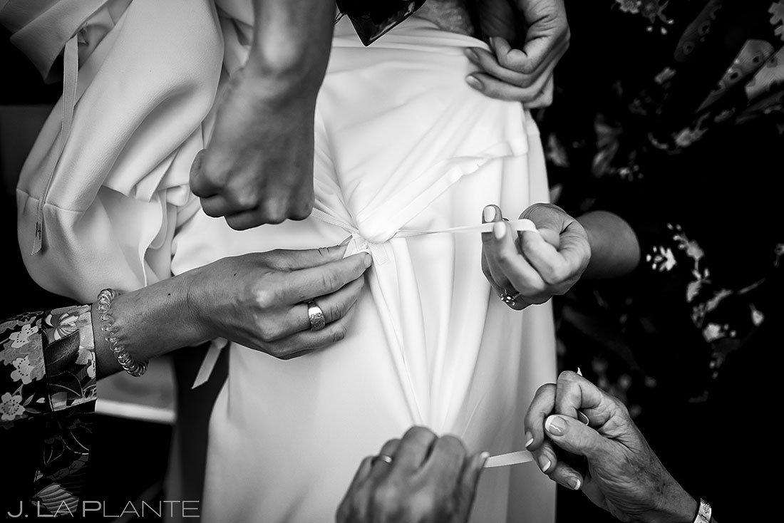 bride getting intro dress