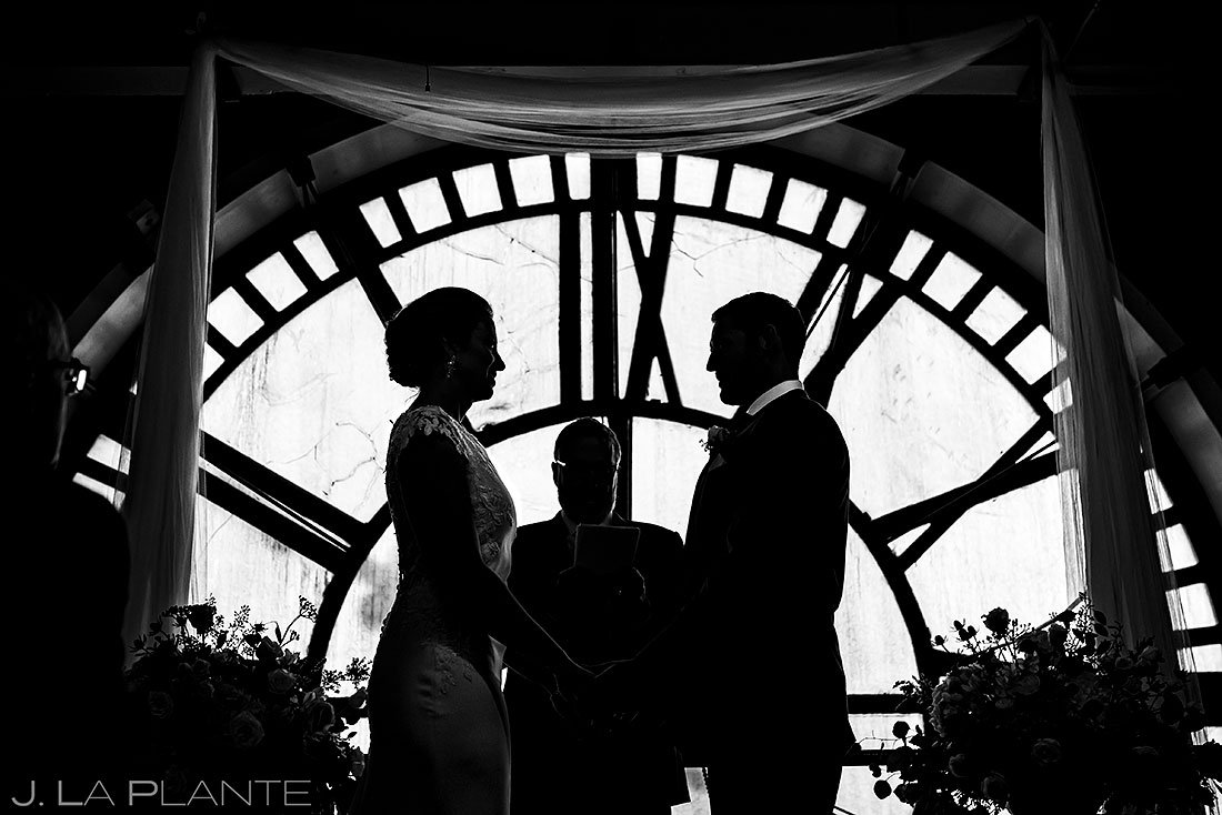 silhouette photo of bride and groom during wedding ceremony