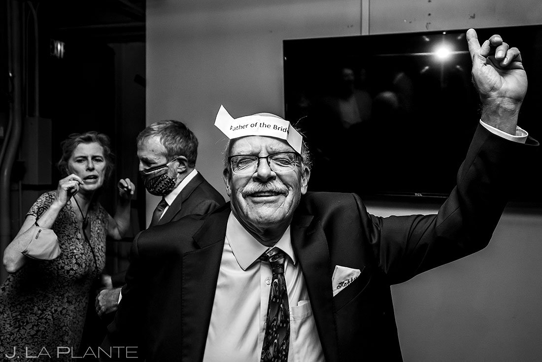 father of the bride dancing during wedding reception