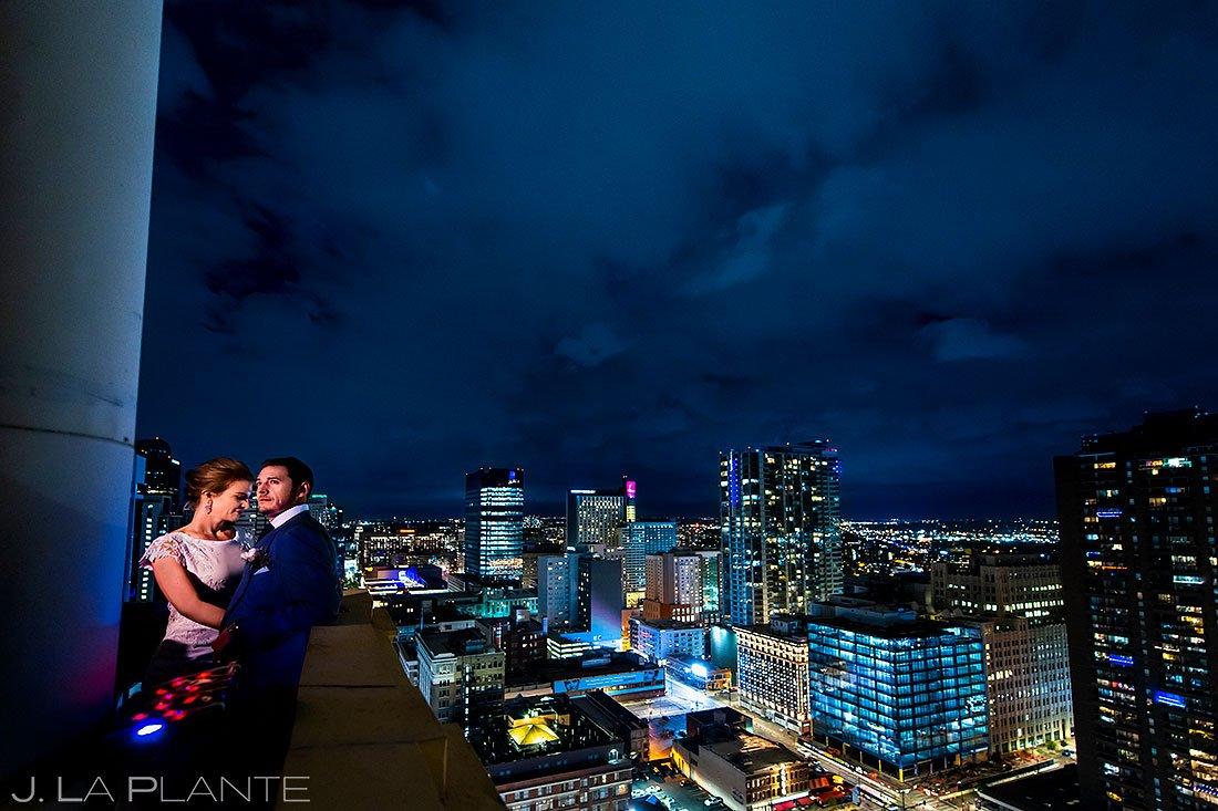denver clock tower wedding bride and groom denver skyline at night
