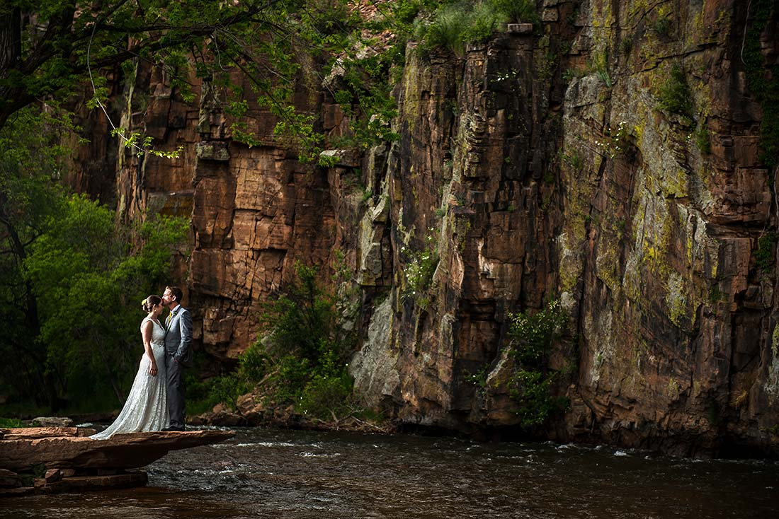 vibrant wedding photography couple next to river in rocky canyon