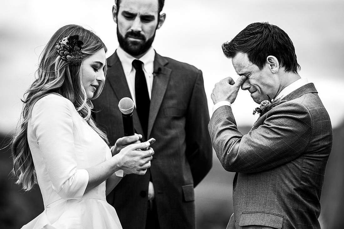 groom crying during vows at wedding ceremony
