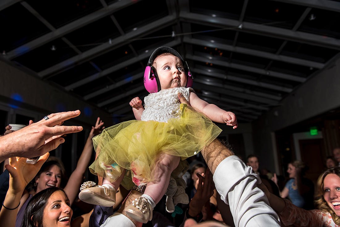 funny photo of baby dancing at wedding reception dance party