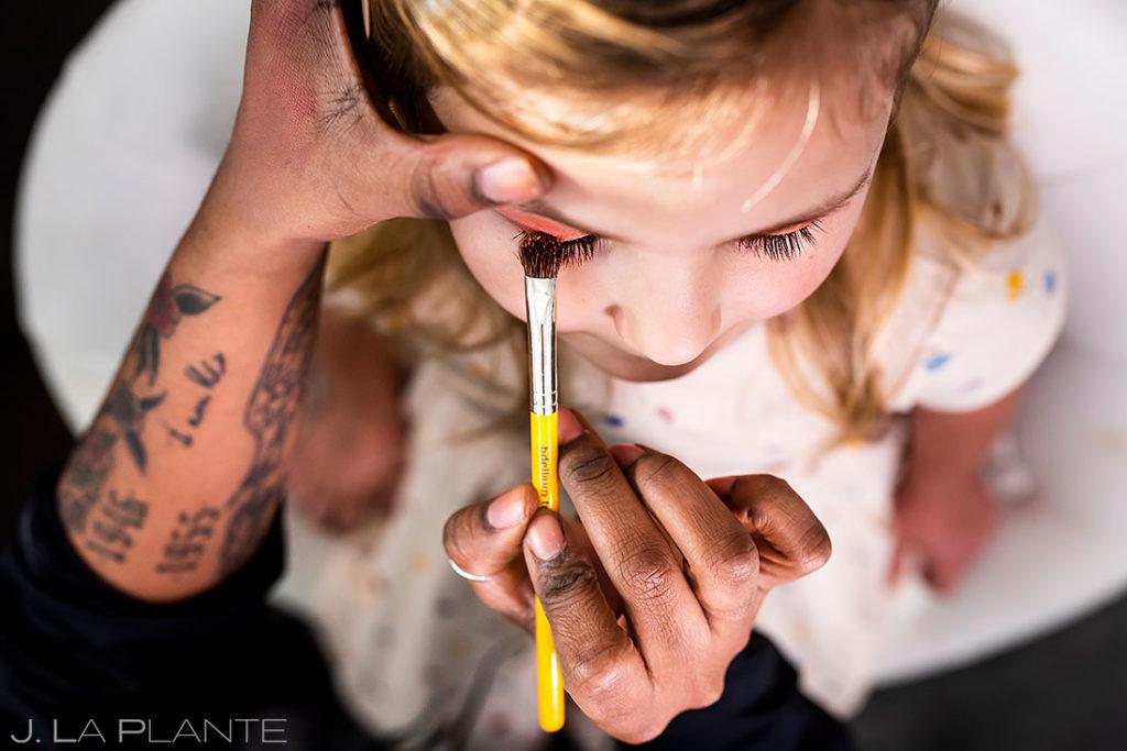 flower girl getting makeup done for houston wedding