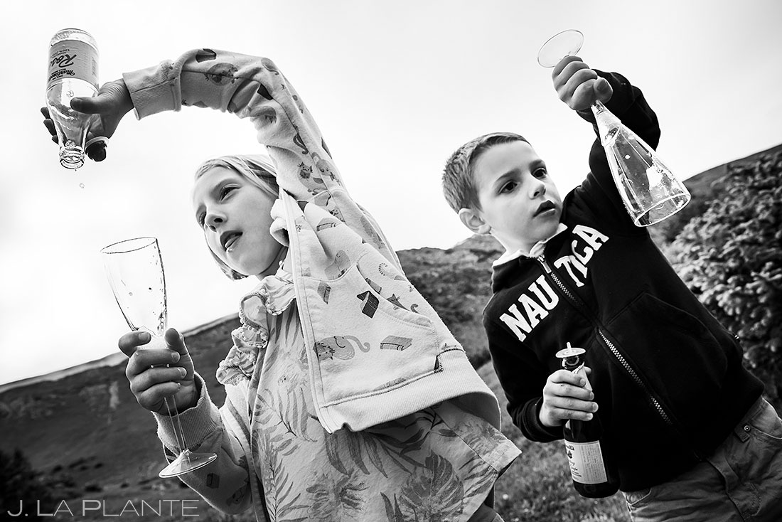 funny photo of kids drinking fake champagne at a wedding