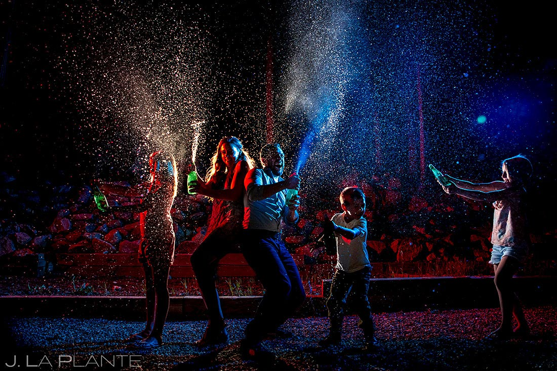 unique family photo session of kids spraying fake champagne