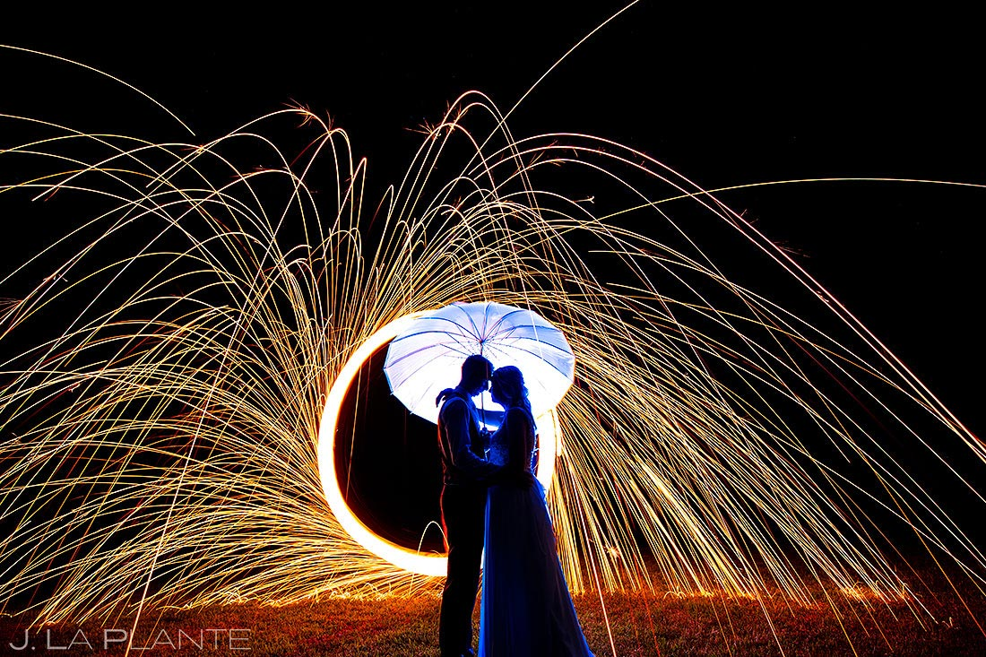 best wedding photos of 2020 | unique nighttime portrait of bride and groom with steel wool