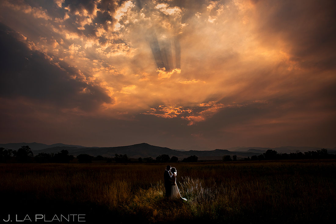sunset wedding photo of bride and groom at Shupe Homestead