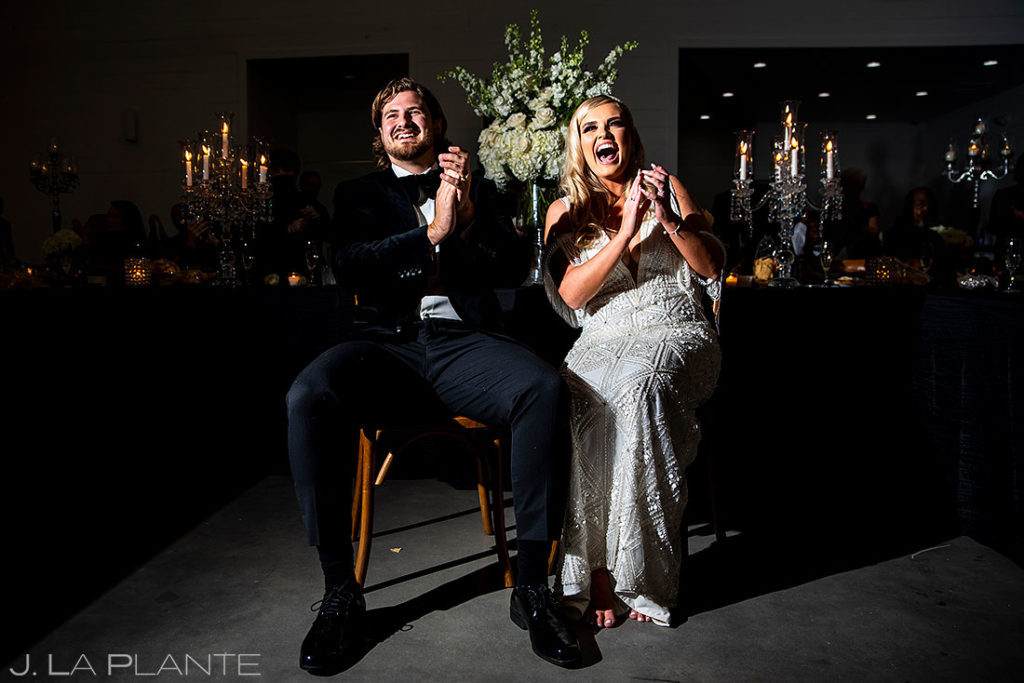 bride and groom laughing during best man toast