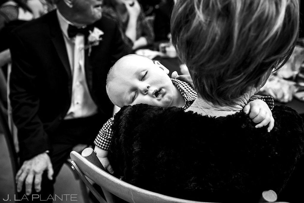 baby sleeping during houston wedding reception