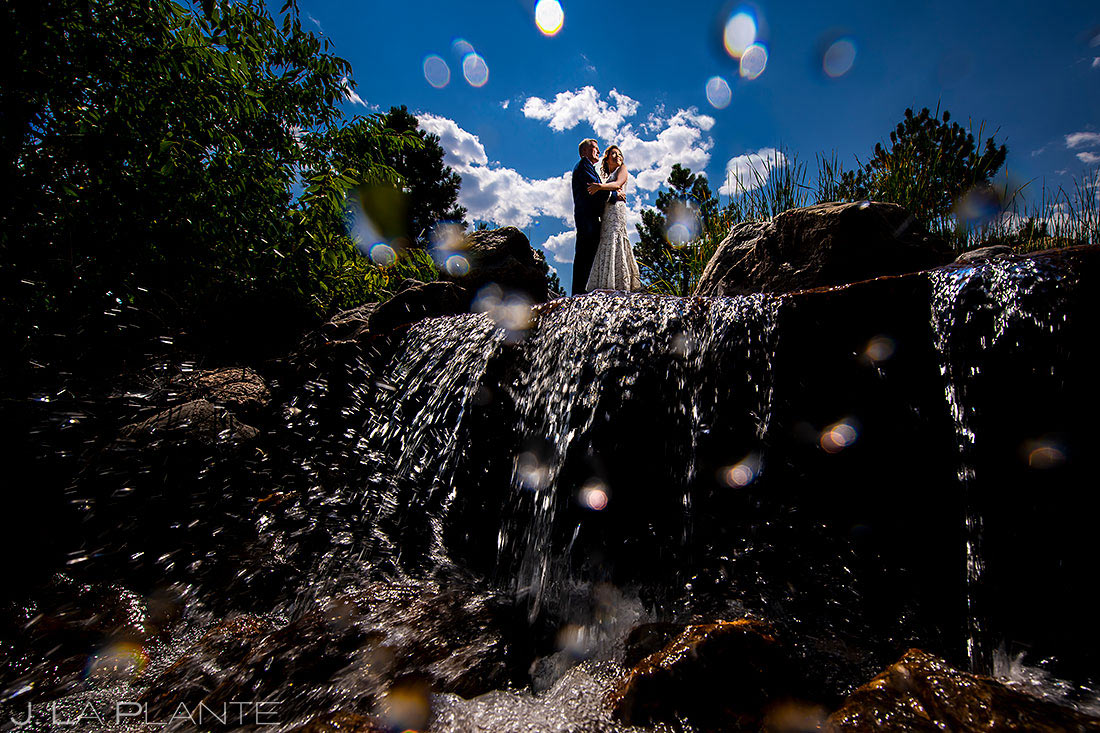 bride and groom on waterfall | best wedding photos of 2020