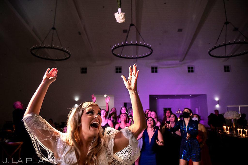 bouquet toss during houston wedding reception