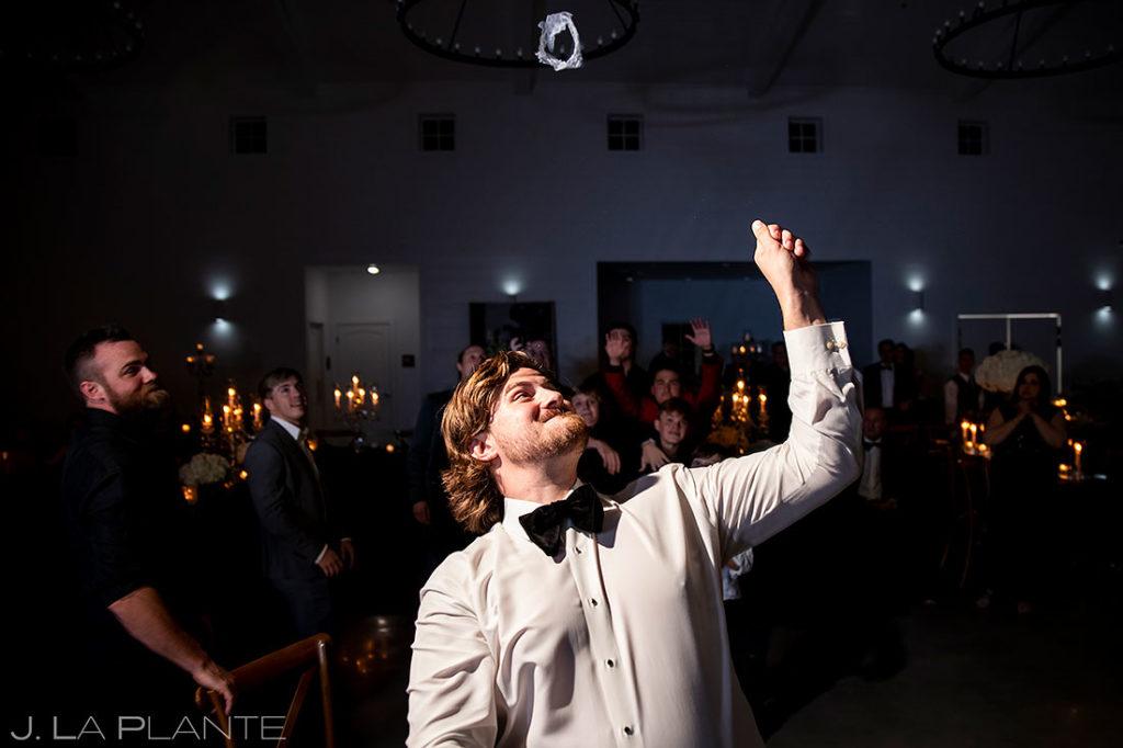 groom tossing the bride's garter