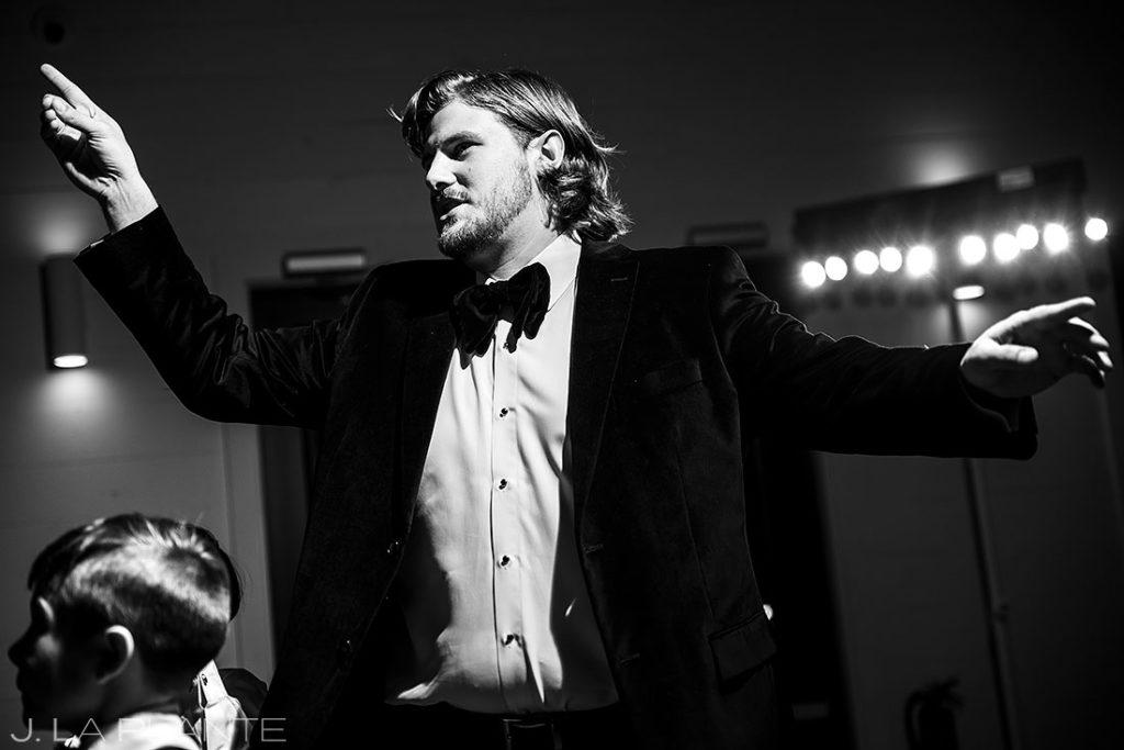 groom dancing during houston wedding reception