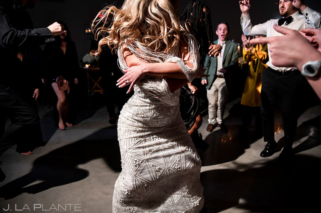 bride showing off her moves on the dance floor
