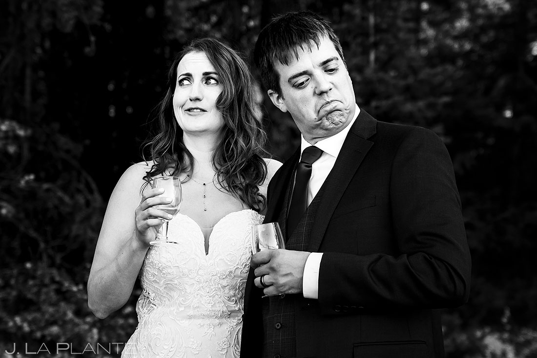 bride and groom making funny faces during wedding toasts