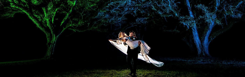 cool nighttime wedding photo of bride and groom at houston wedding